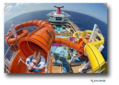A guest prepares for an exhilarating ride down the Kaleid-O-Slide, a 455-foot-long tube slide on the new Carnival Vista