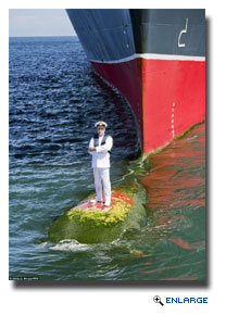 QM2 Captain Stands On Bulbous Bow