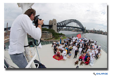 More than 120 crew aboard Cunard Line's flagship Queen Mary 2 gathered together on the ship's bow in Sydney